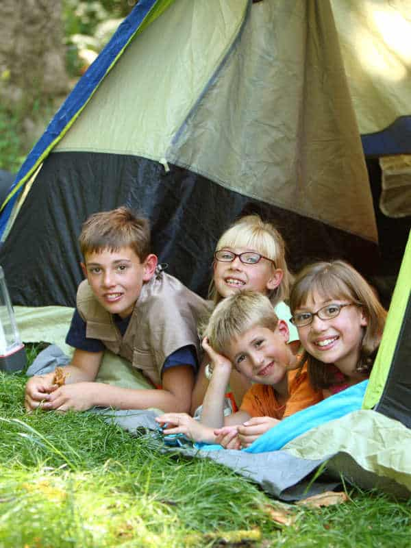 four kids in a tent camping