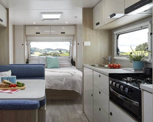 Bed with kitchen and dining table